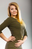Attractive blonde woman wearing tight green khaki dress - 216042838