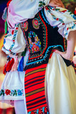 Detail of Romanian folk costume for women and man - 216052206