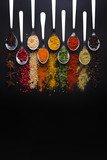 Spices and condiments for cooking on a black background, the image has a space available to add texts - 216057686