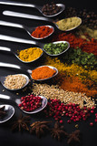 Spices and condiments for cooking on a black background - 216057694