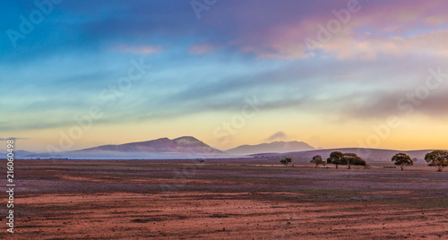 Fotobehang Beige Flinders Ranges peaks and gum trees covered by low morning clouds at colorful sunrise in South Australia