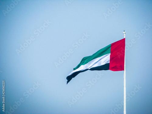 Foto Spatwand Abu Dhabi The United Arab Emirates flag waving