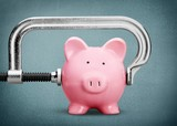 Pink piggy bank and clamp on background - 216070490