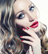 Quadro Beautiful woman face closeup with long blond hair and vivid red lipstick