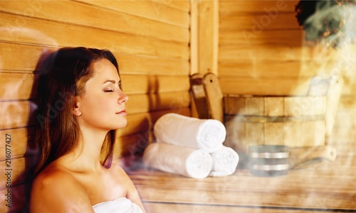 Leinwanddruck Bild Young woman relaxing in spa