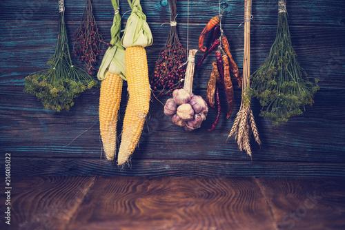 Leinwandbild Motiv Autumn vegetables harvest hanging on wooden wall