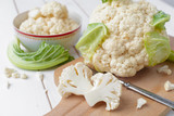 Organic cauliflower on wooden background