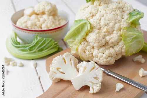 Leinwandbild Motiv Organic cauliflower on wooden background