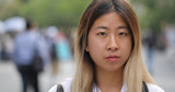 Young Asian woman in city serious face portrait - 216089803