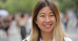 Young Asian woman in city smile happy face portrait - 216089816
