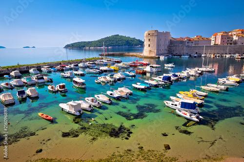 Leinwanddruck Bild Dubrovnik harbor and city walls view