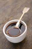 molasses treacle in dish - 216100858