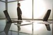 businessman standing near the window in a modern office