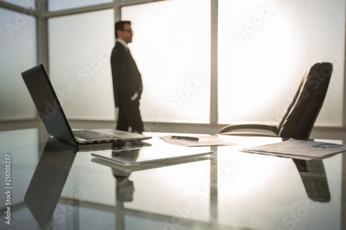 Leinwandbild Motiv businessman standing near the window in a modern office