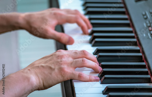 Playing piano close up photo - 216112402