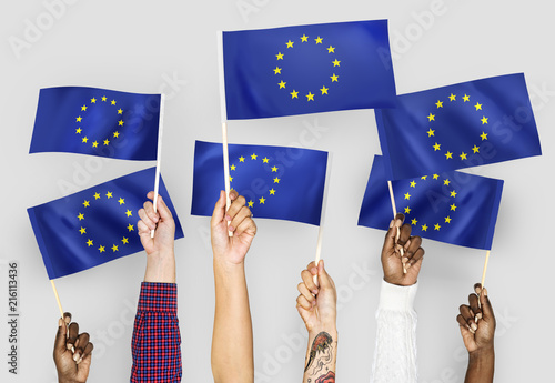 Leinwandbild Motiv Hands waving flags of the EuropeanUnion