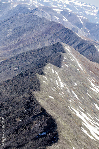 Northern landscape. The mountains are covered with glaciers. View from helicopter flight altitude