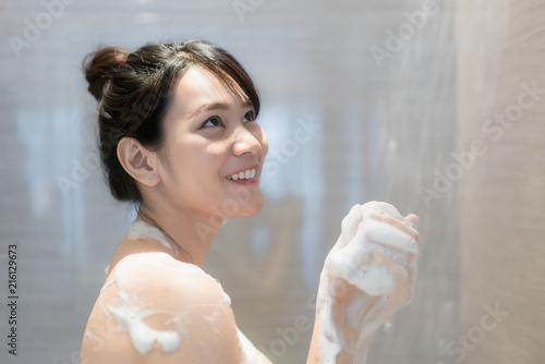 Asian girl taking shower