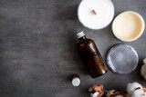 Natural spa cosmetic products from above on gray concrete table. Beauty blogger, salon treatments, minimalism concept - 216162284