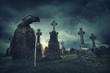Leinwanddruck Bild - Spooky old graveyard and a bird