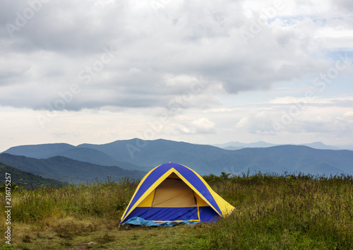 Yellow and Blue Tent on top of Mountains