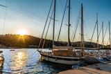 Beautiful sunset over Lefkada island in Greece. Sail boat on the harbor of Vasiliki port,