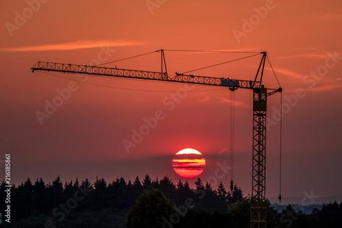 Foto Spatwand Baksteen Neubaugebiet bei Sonnenuntergang