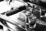 making espresso coffee close up detail with modern machine - 216186013