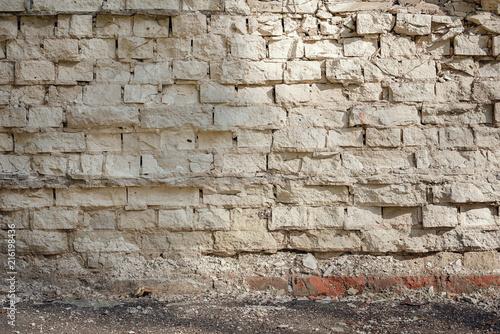 Brick wall and asphalt floor background.