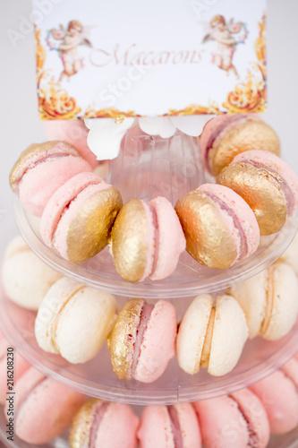 Aluminium Macarons Close up of golden macarons with text