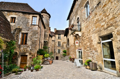 Picturesque medieval street the beautiful Dordogne village of Carennac, France