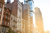 Sunlight reflection on the windows of historic buildings along 23rd Street in Manhattan New York City - 216217606