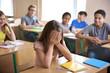 Leinwanddruck Bild - Sad girl sitting in classroom. Bullying at school