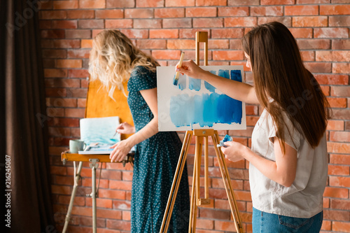 art school classes. creativity painting self expression and artful leisure. girl learning to draw with watercolors on easel.