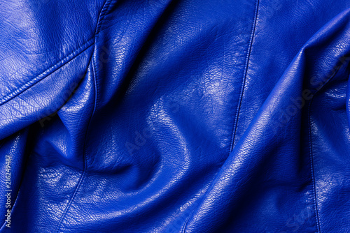 top view of dark blue leather shiny textile as background