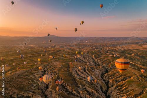 Foto Spatwand Zalm hot air balloons during snrise Cappadocia Kapadokya Turkey, Fairytale landscape hills