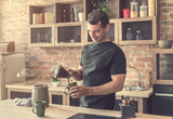 handsome man pours freshly brewed coffee into cups - 216262683