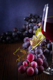 Glass with red wine and grapes - 216263450