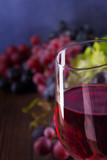 Close-up of glass with red wine and grapes