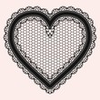 Black lacy openwork heart. Gentle luxurious accessory for the design of invitations, cards or decoupage.