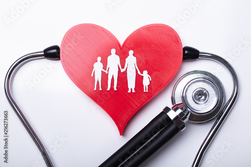 Foto Murales Stethoscope Examining Heart With Family Figures