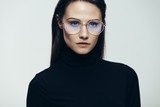 Woman in glasses with intense expression - 216275082