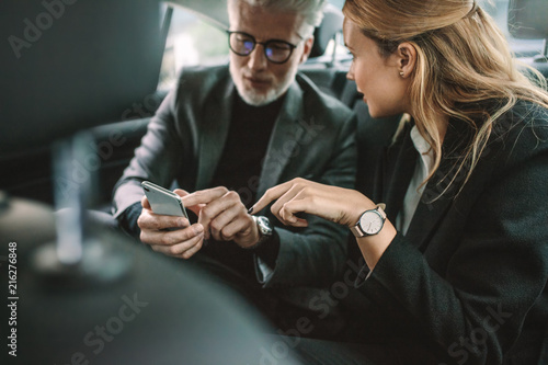 Sticker Business people using smart phone in taxi