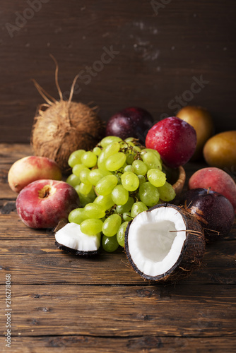 Foto Murales Concept of vegan food with coconut, grape, peache and plums