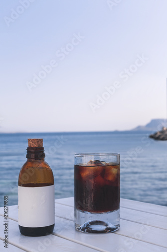 Foto Murales Summer Drink Cold Brew Coffee with a Bottle on the Seaside.