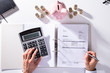 Leinwandbild Motiv Elevated View Of Businessman Calculating Invoice