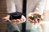 Human Hand Holding Graduation Hat And Golden Coins - 216283837