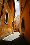 Rome city narrow street with old orange buildings