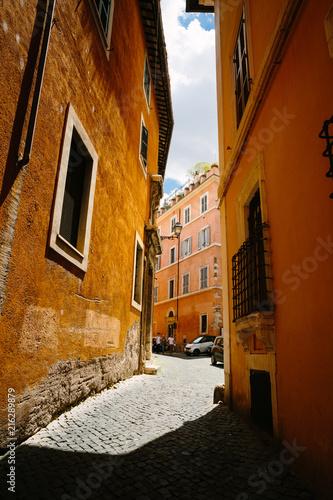 Aluminium Smalle straatjes Rome city narrow street with old orange buildings