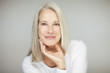 Leinwandbild Motiv stunning beautiful and self confident best aged woman with grey hair smiling into camera, portrait with white background